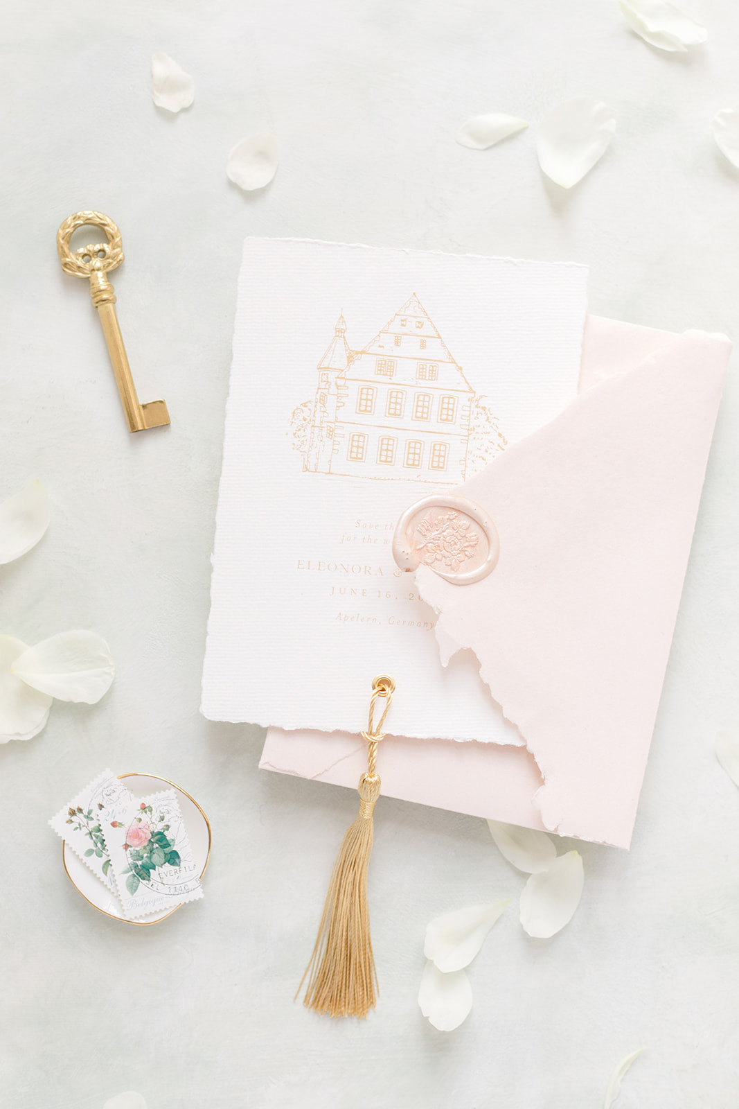bonjour paper save the date card featuring the sketch of the castle